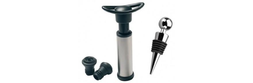 Vacuum pump, nozzles and caps